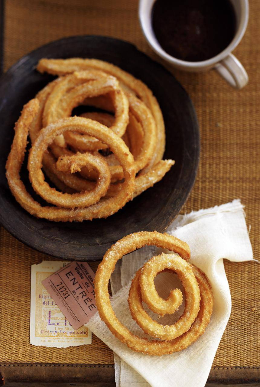 A plate of Spanish churros, and coffee