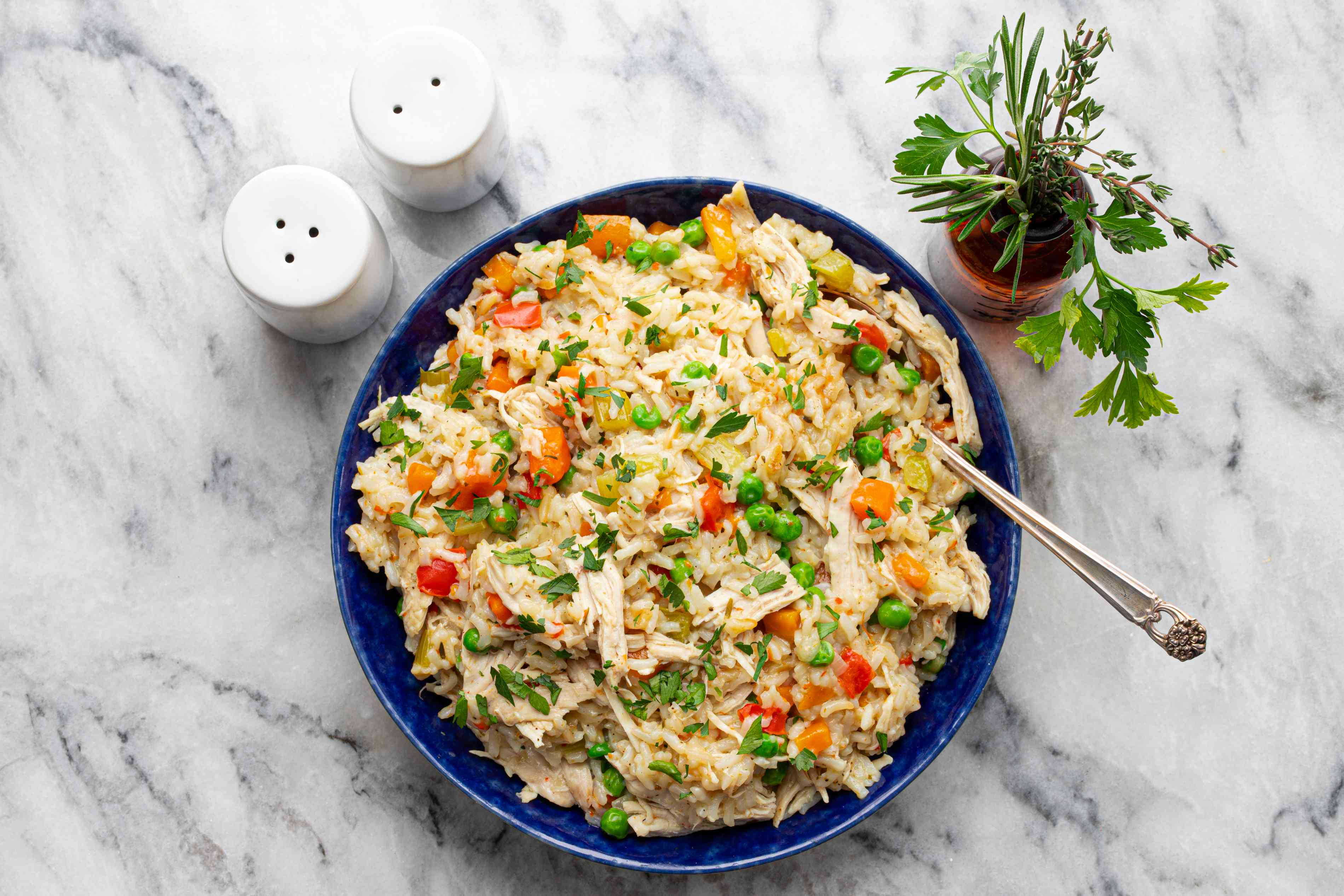 Instant pot chicken and rice with serving spoon