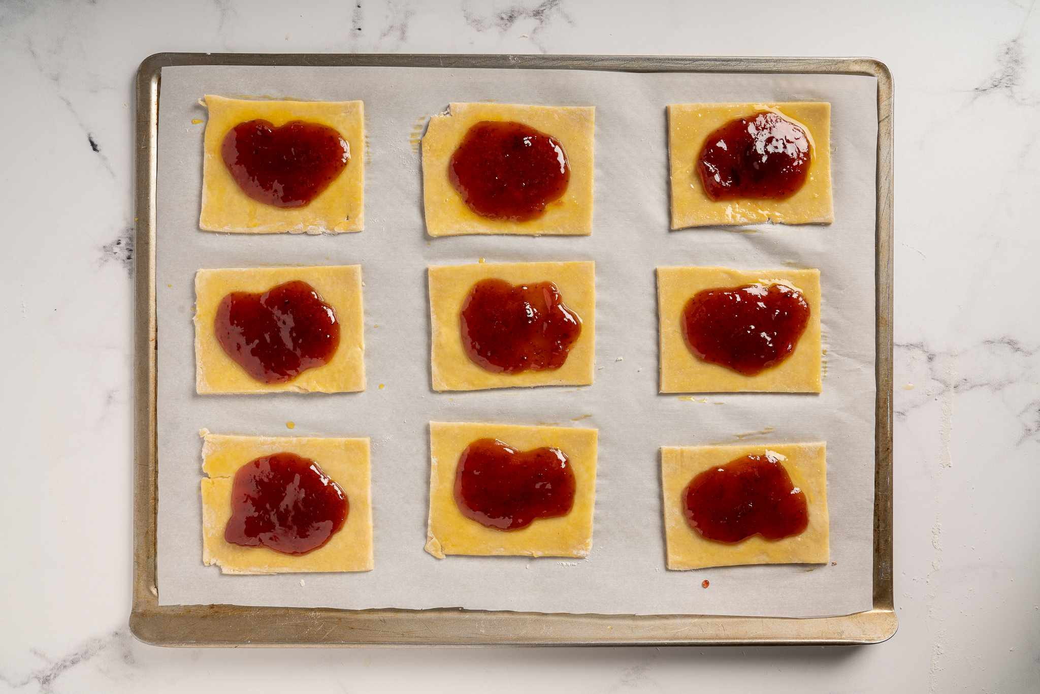 Rectangles of dough topped with strawberry filling