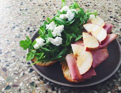 Goat cheese, apple, rosemary ham & honey sandwich with fresh arugula