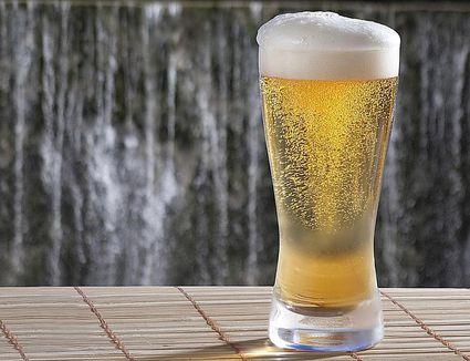 Glass of foaming beer