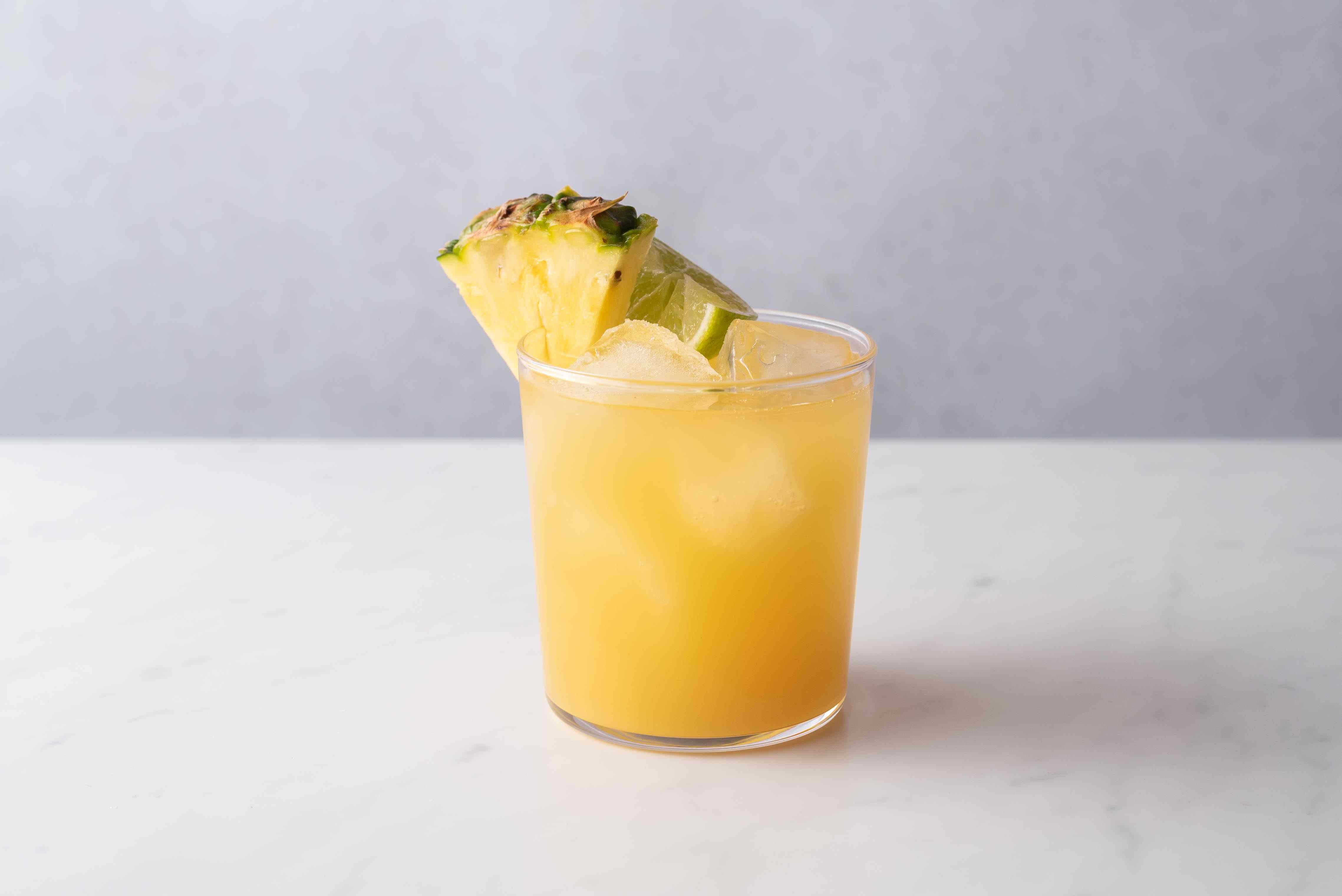 Pineapple Tequila Mixed Drink, garnished with pineapple and lime
