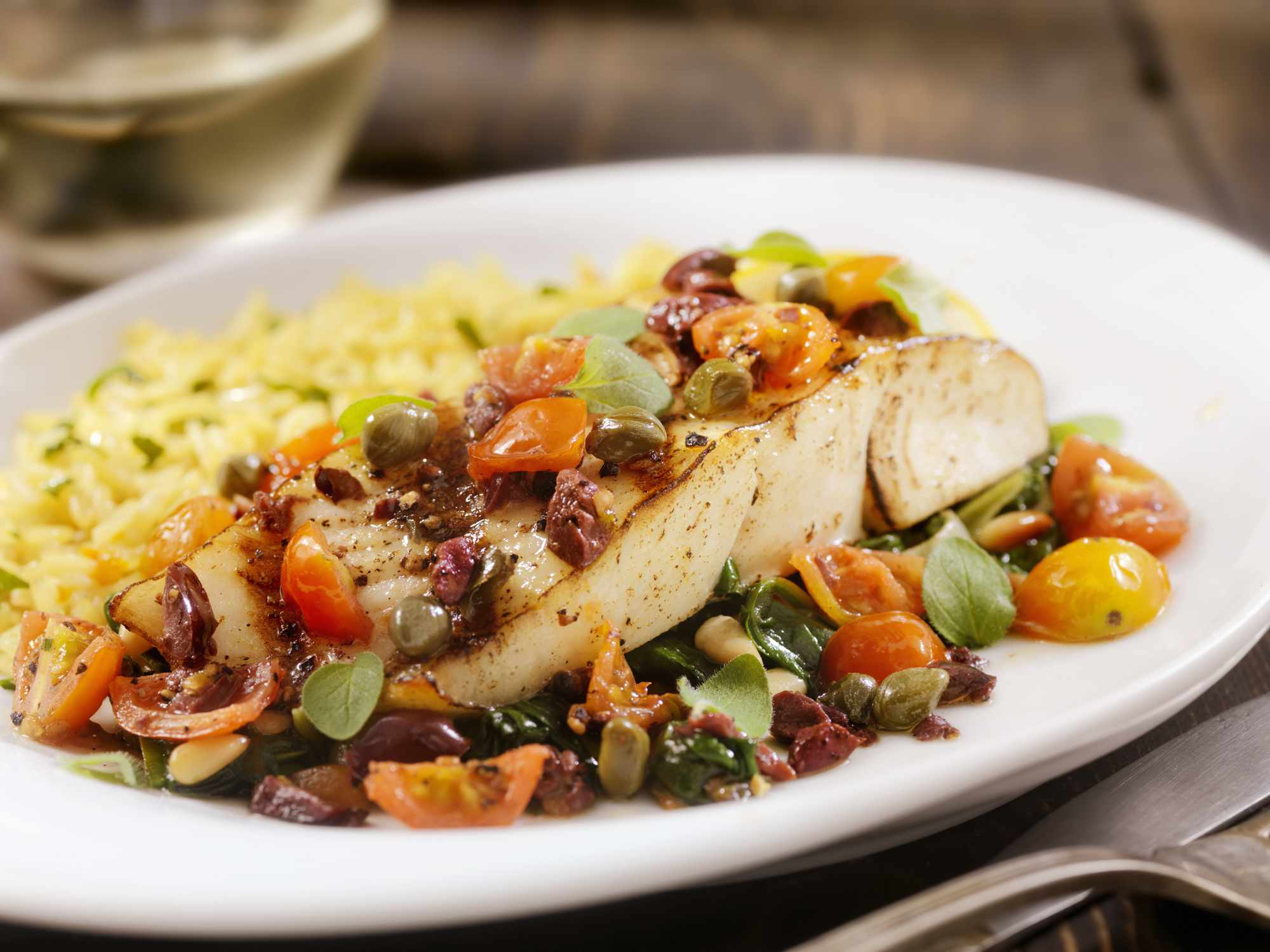 Grilled halibut with capers, olives, and tomatoes
