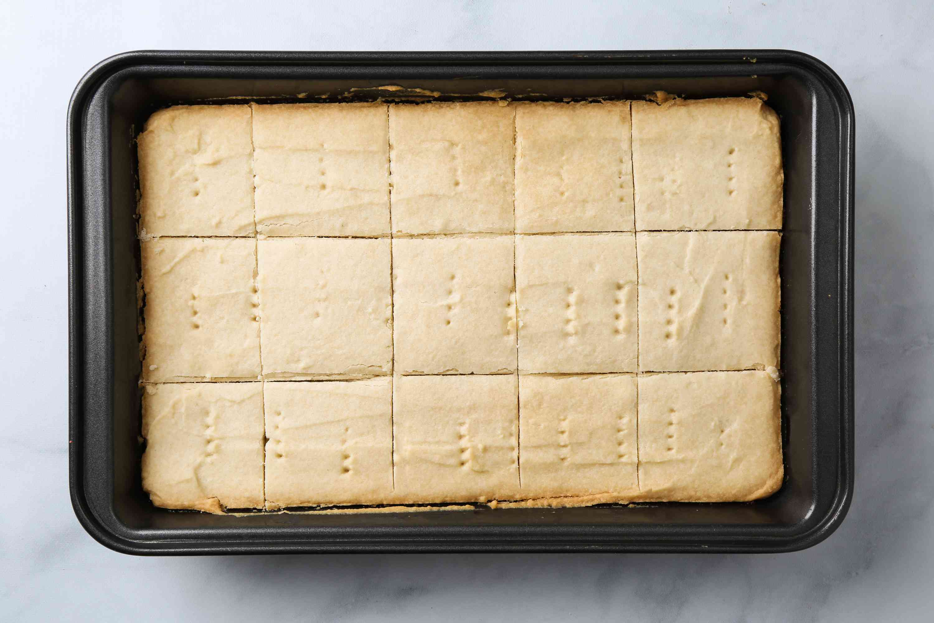 shortbread in a baking dish, sliced into pieces