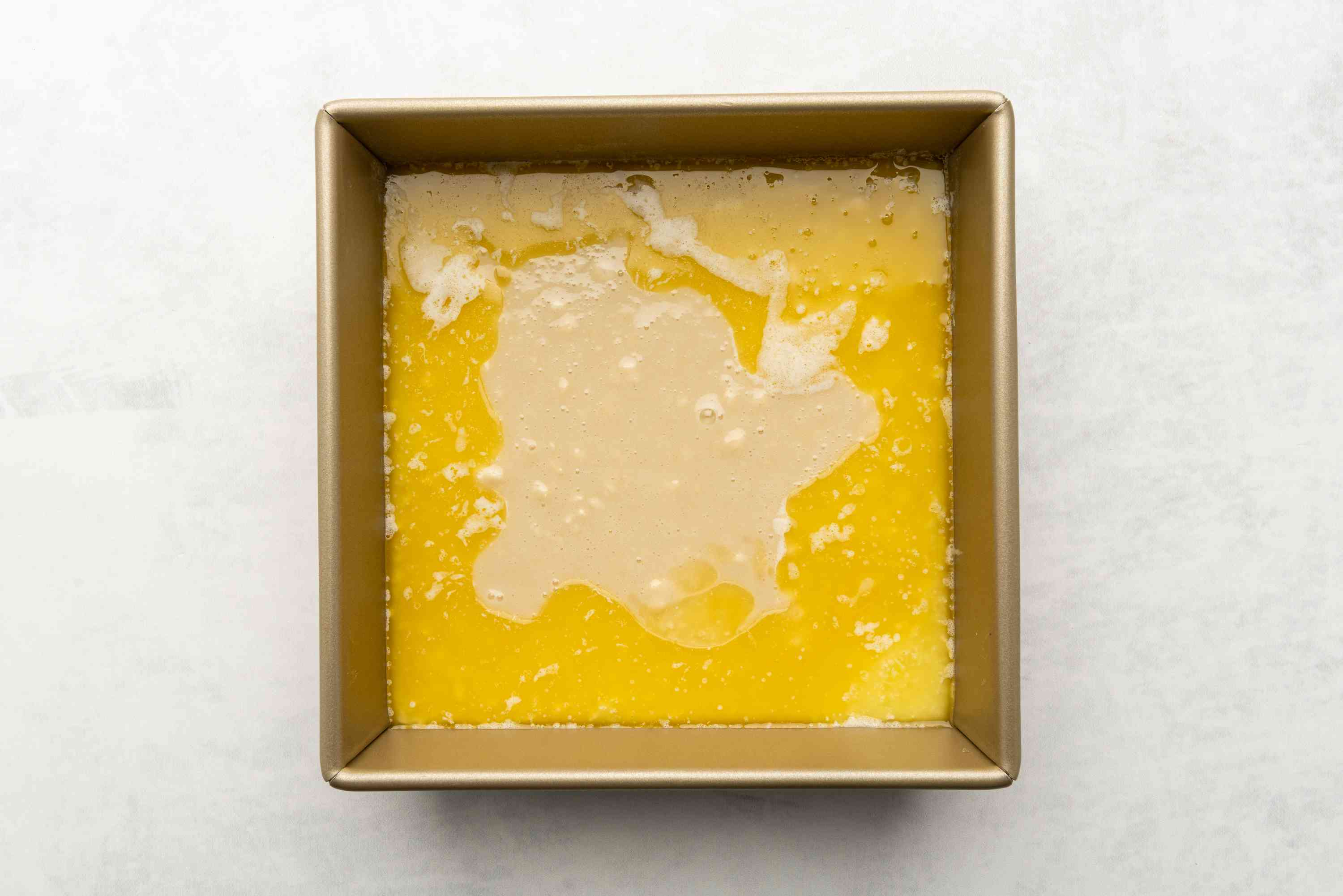 melted butter in a baking dish