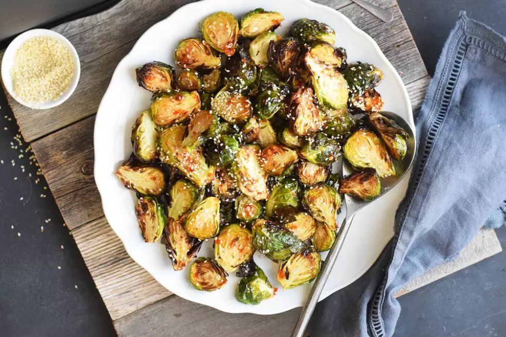 Air fryer Brussels sprouts on a white serving plate
