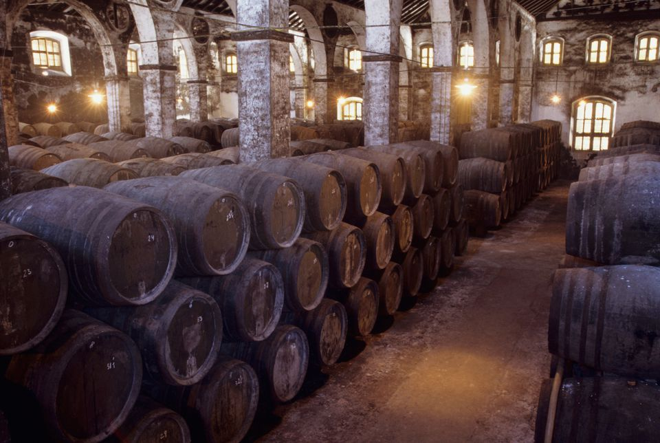 Interior of old Sherry bodega (wine cellar) with sherry casks, Sanlucar de Barrameda, Andalusia, Spain