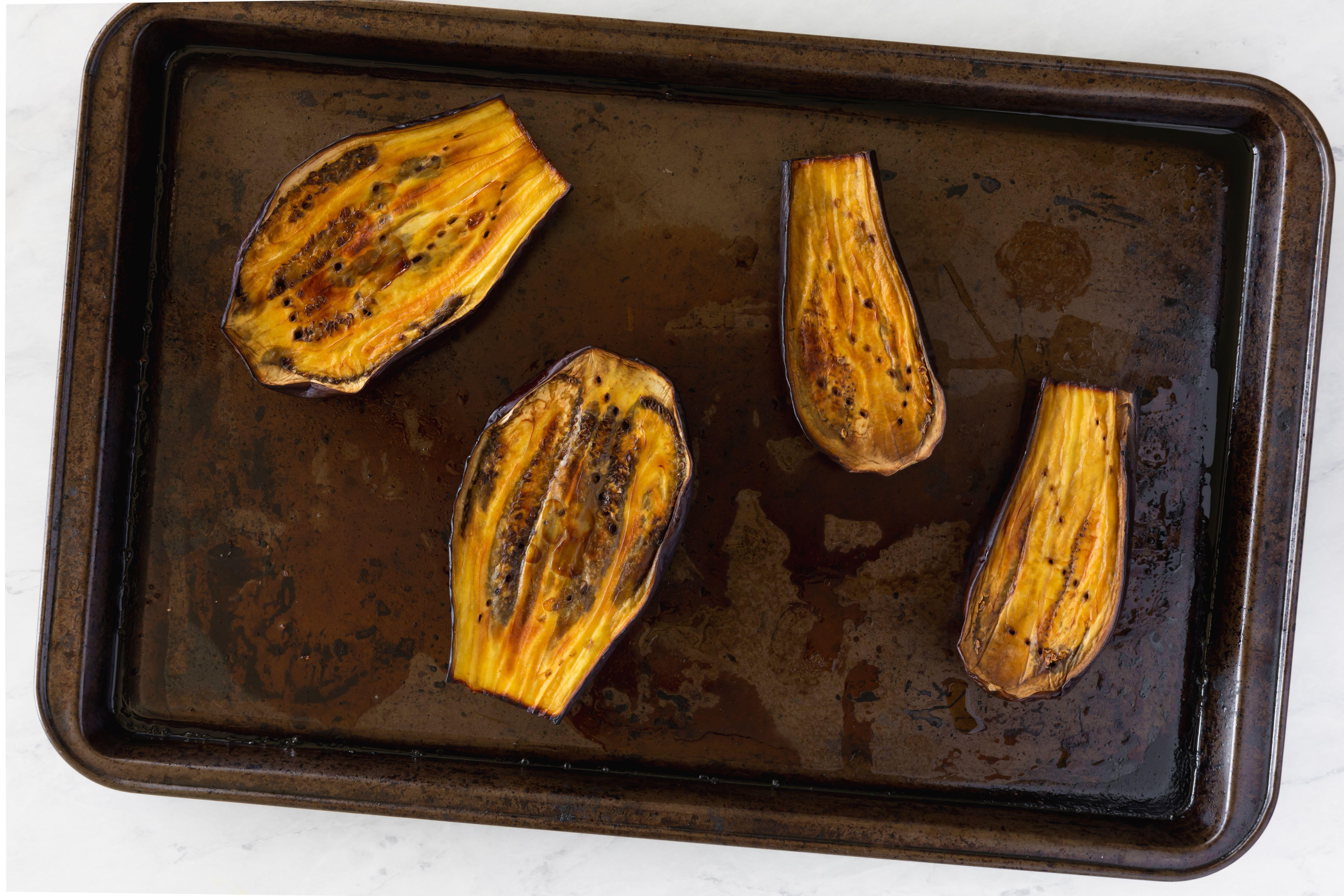 Roast sliced eggplants in the oven