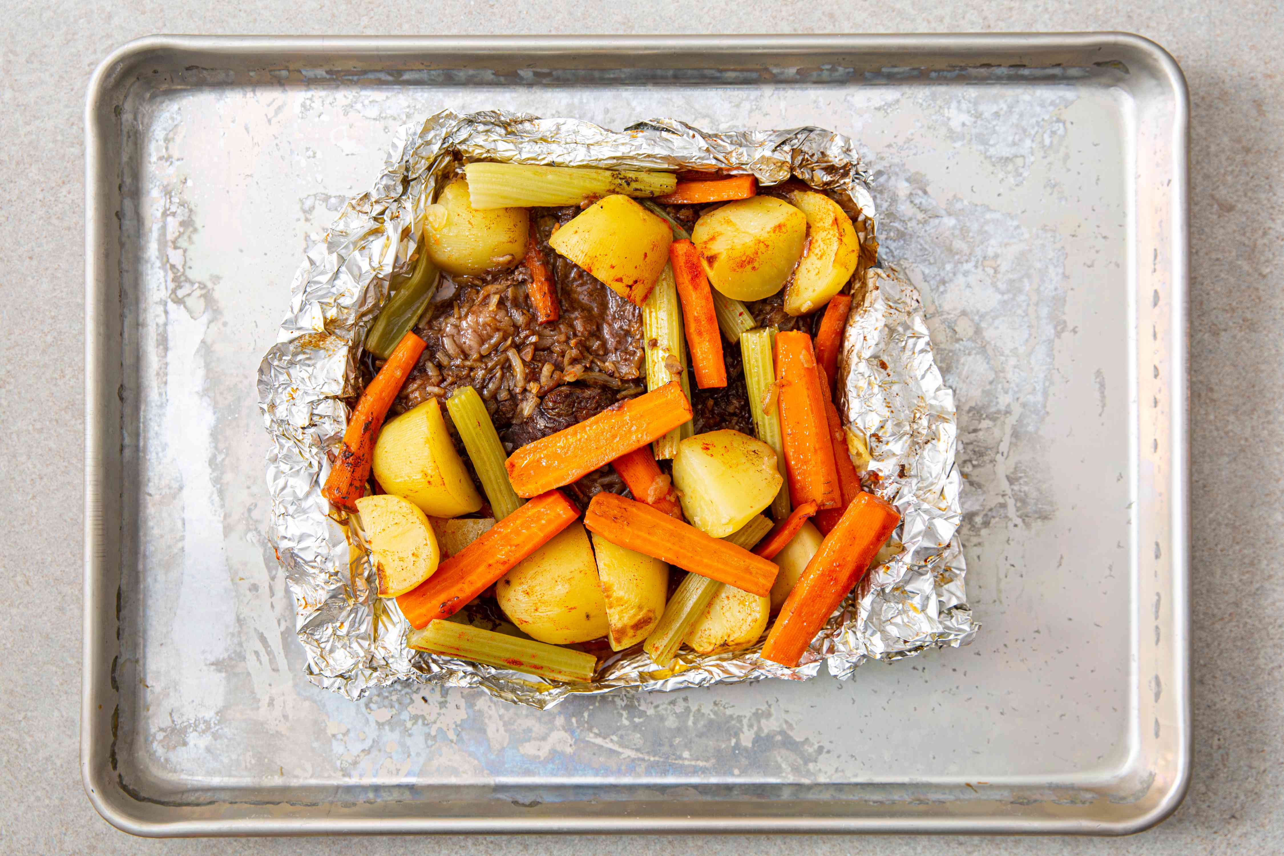 Baked chuck steak and vegetables