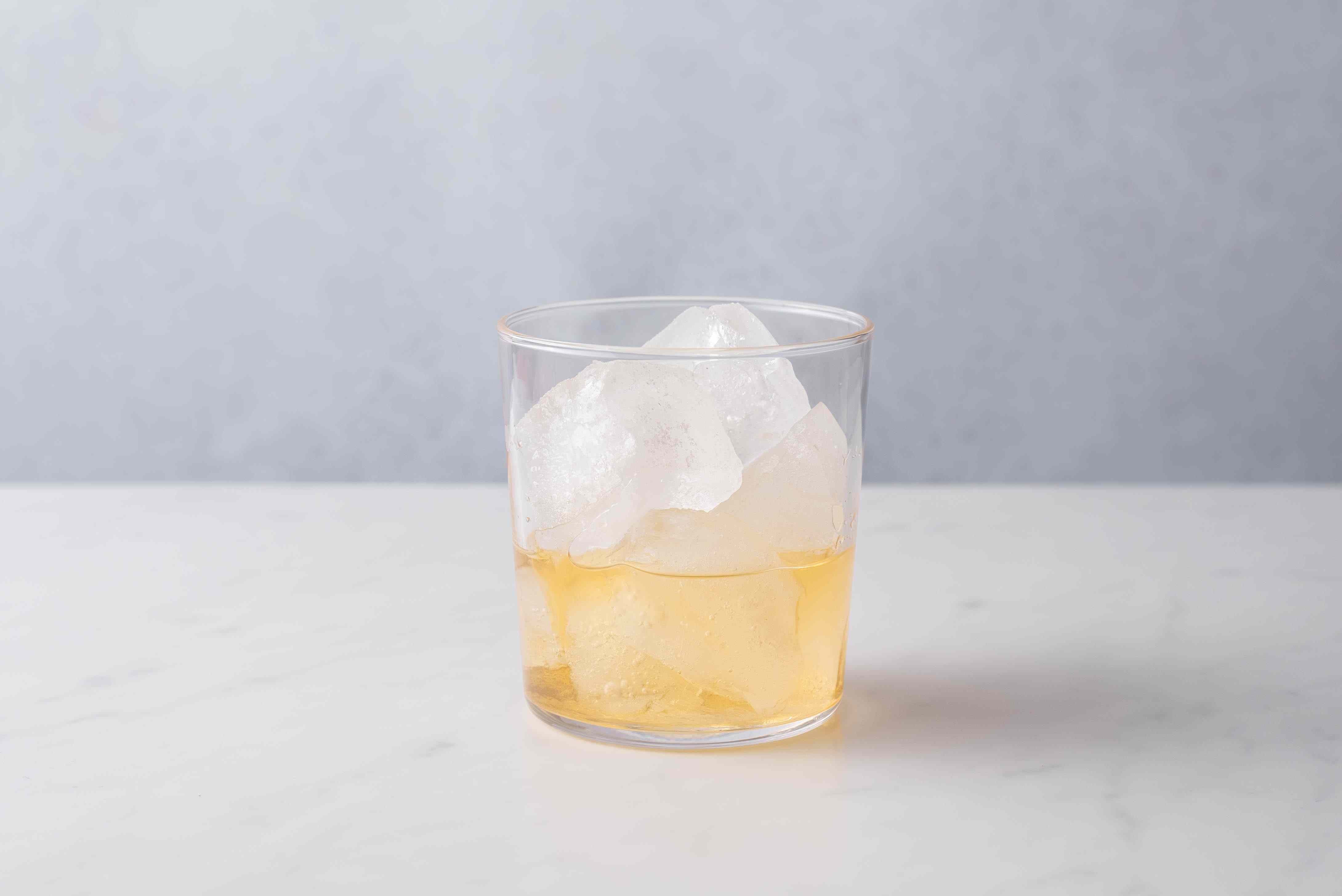 pour the tequila and orange liqueur into a with ice