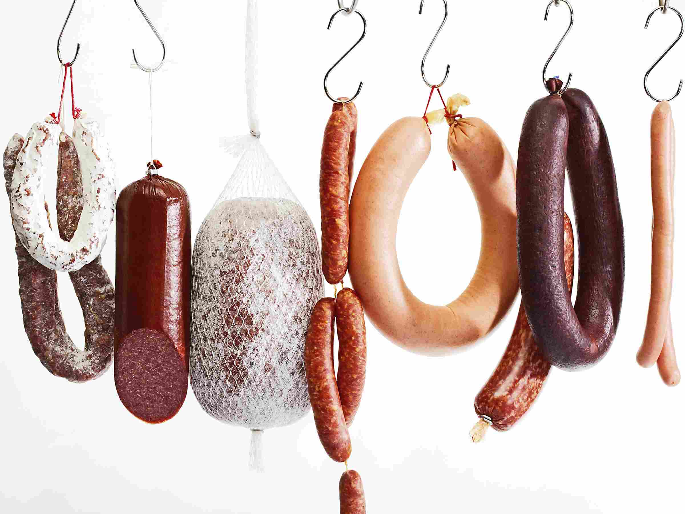 A variety of sausages on hooks