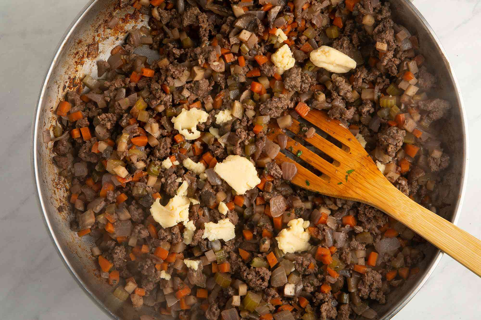 add the flour and butter mixture to meat mixture in the pan