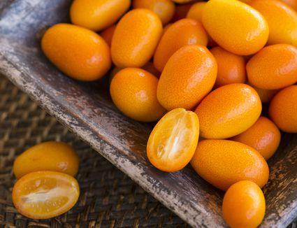 Whole and halved kumquats