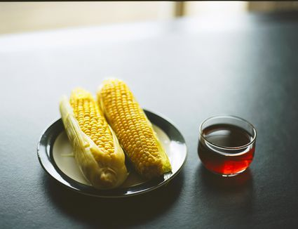 Corn and a glass of corn tea