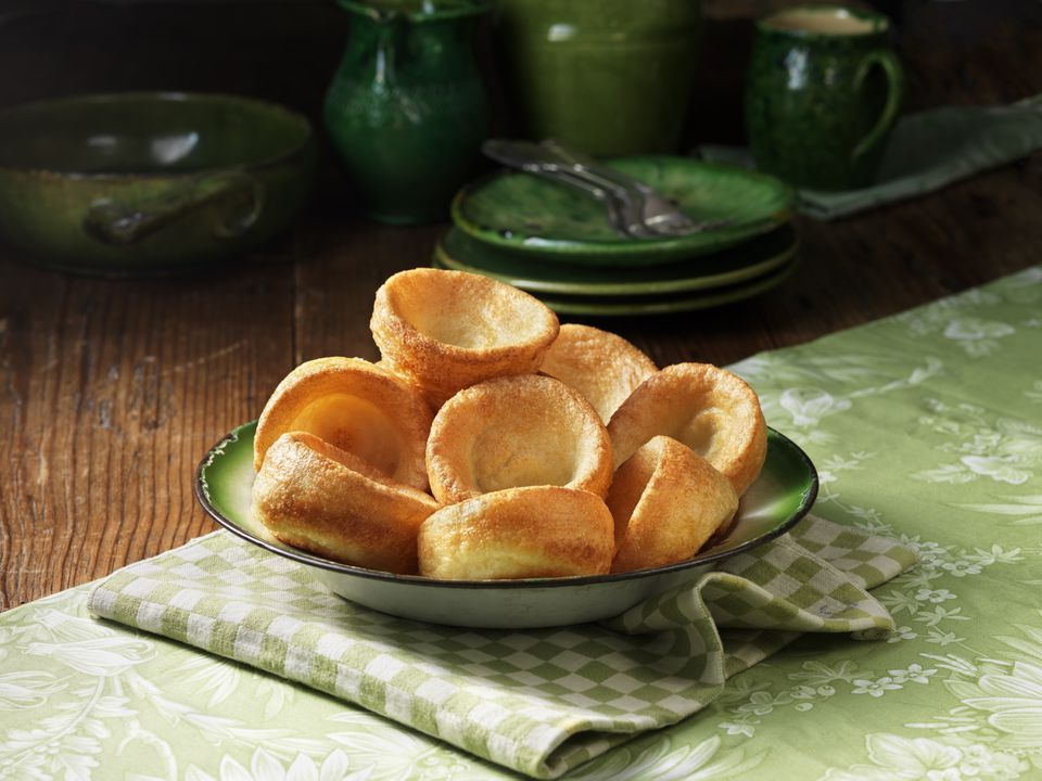 Bowl of yorkshire pudding with green colour pottery