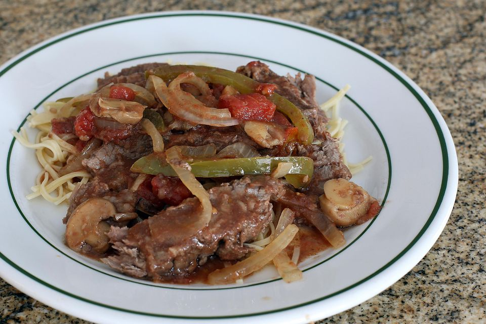 Crock pot smothered steak on fine noodles
