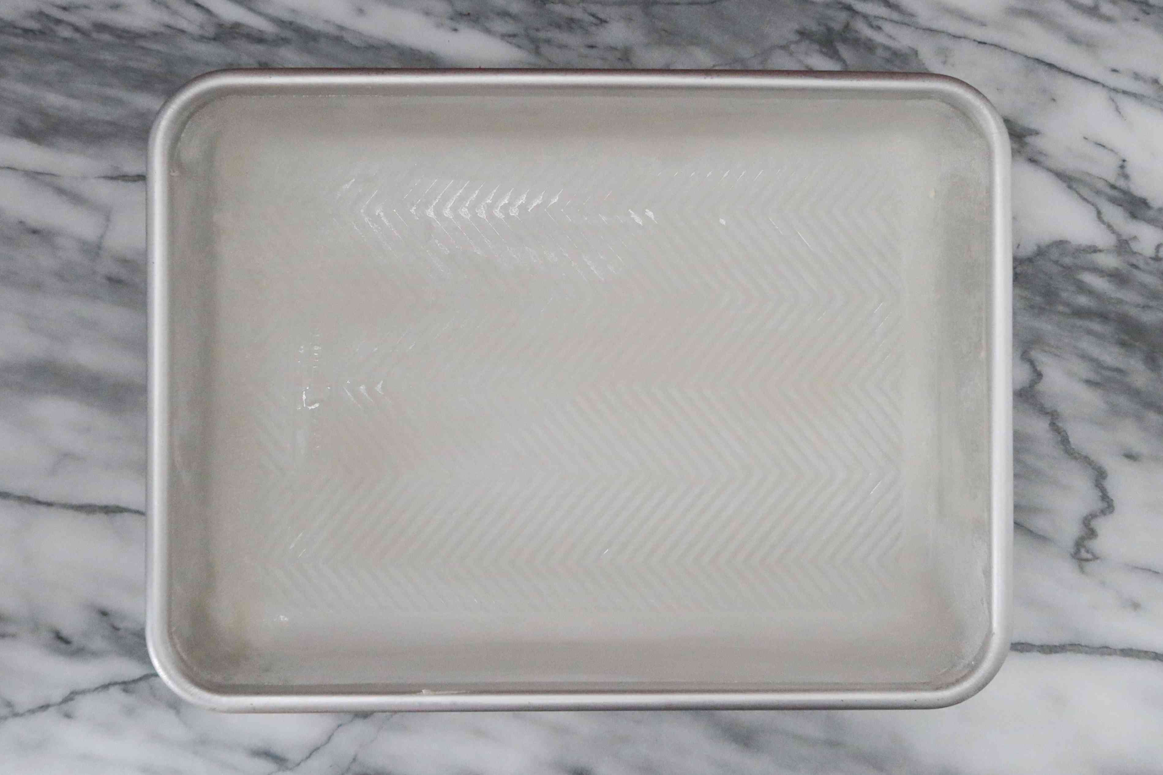 grease and flour the cake pan