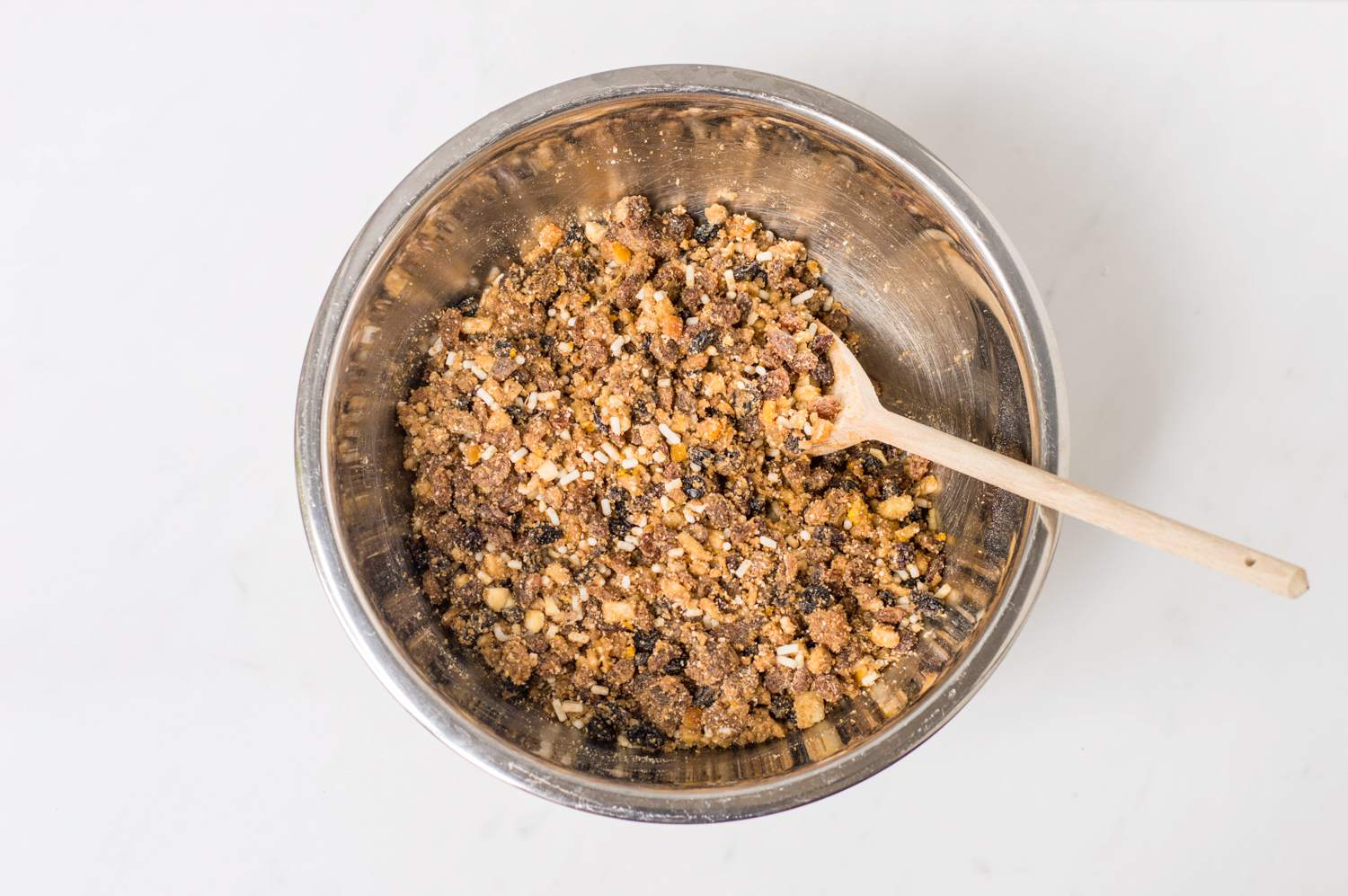 Add dry ingredients to a bowl and add dried fruit mixture