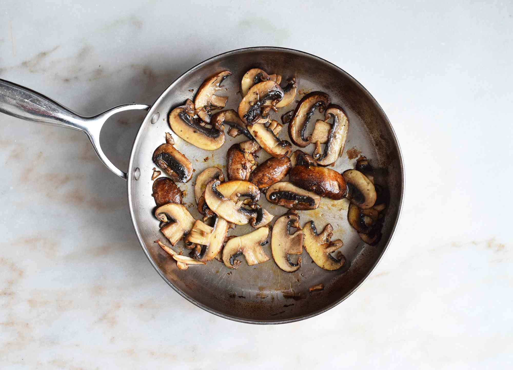 mushrooms sautéing in a skillet
