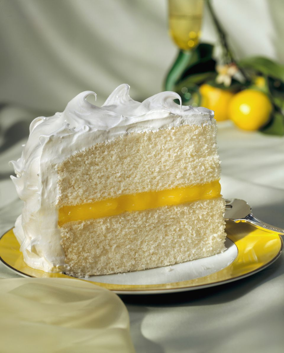 Piece of sponge cake with lemon cream and meringue