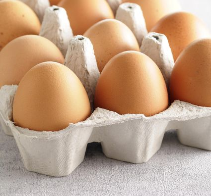A close-up of an open pack of eggs