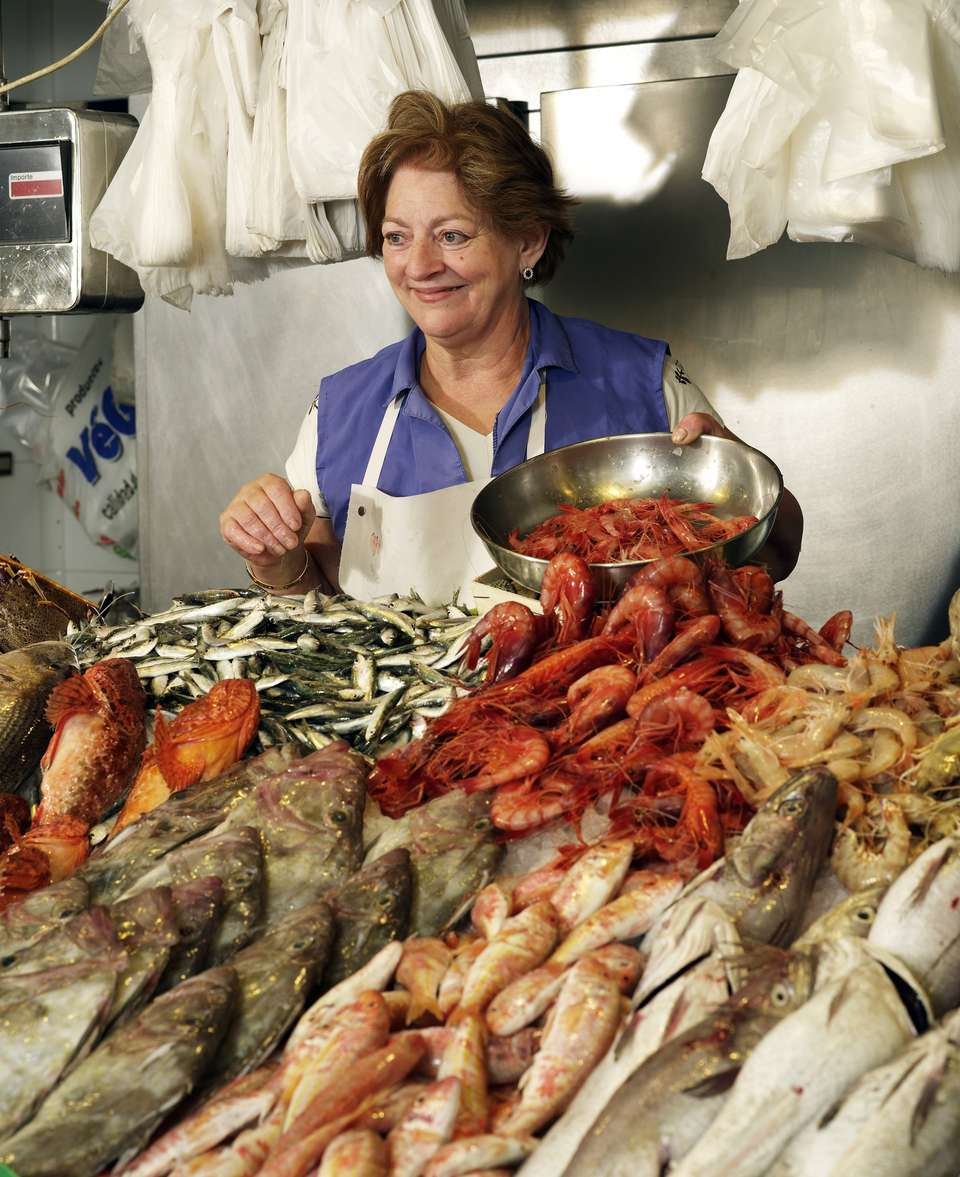 Woman sells fish at stand
