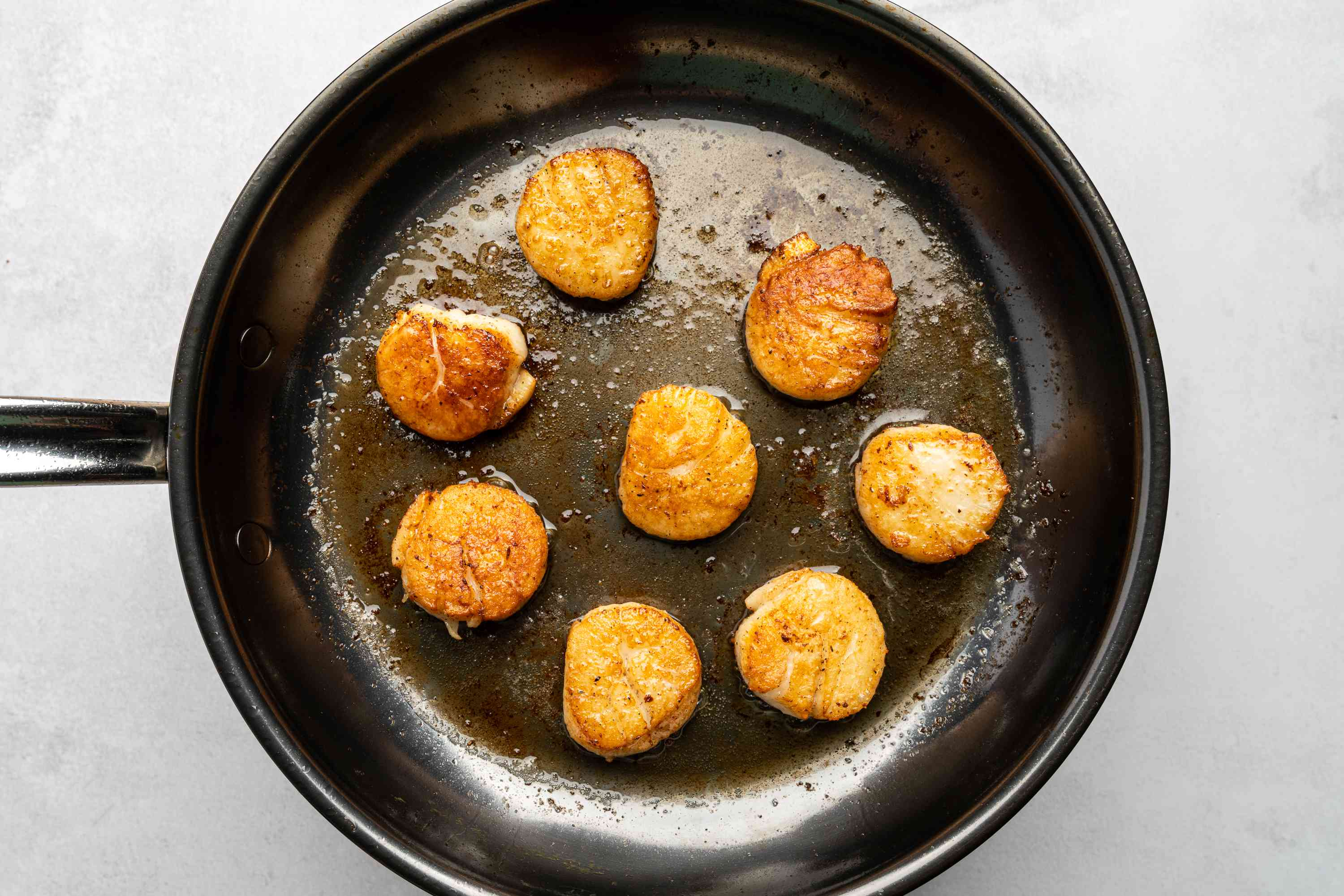 scallops cooking in a pan