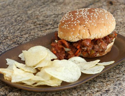 Barbecue beef sandwich and potato chips on a plate