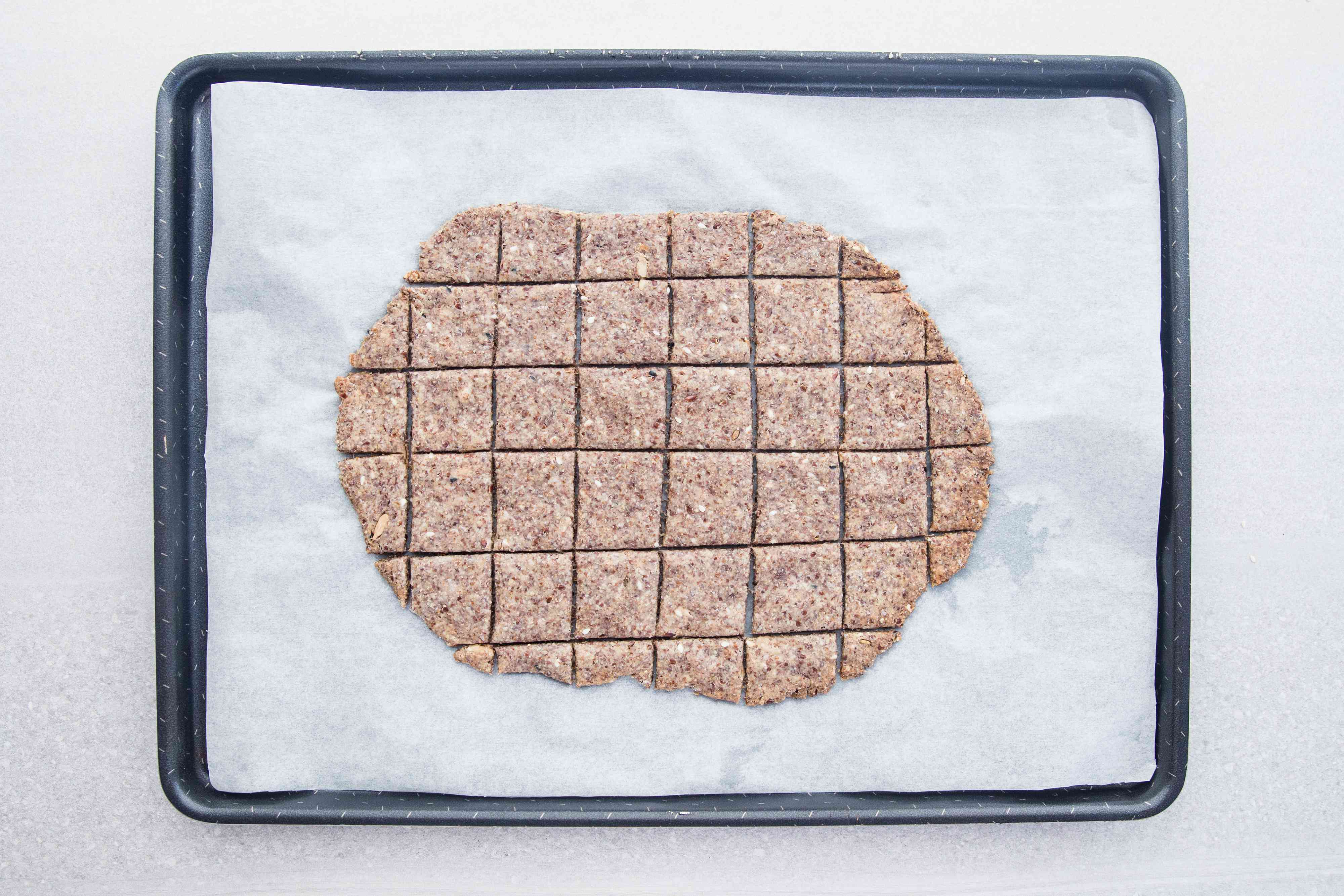 Bake the scored cracker dough on the baking sheet