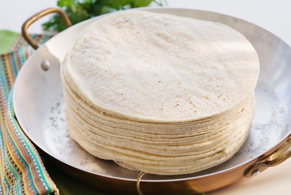 Stack of tortillas in pan