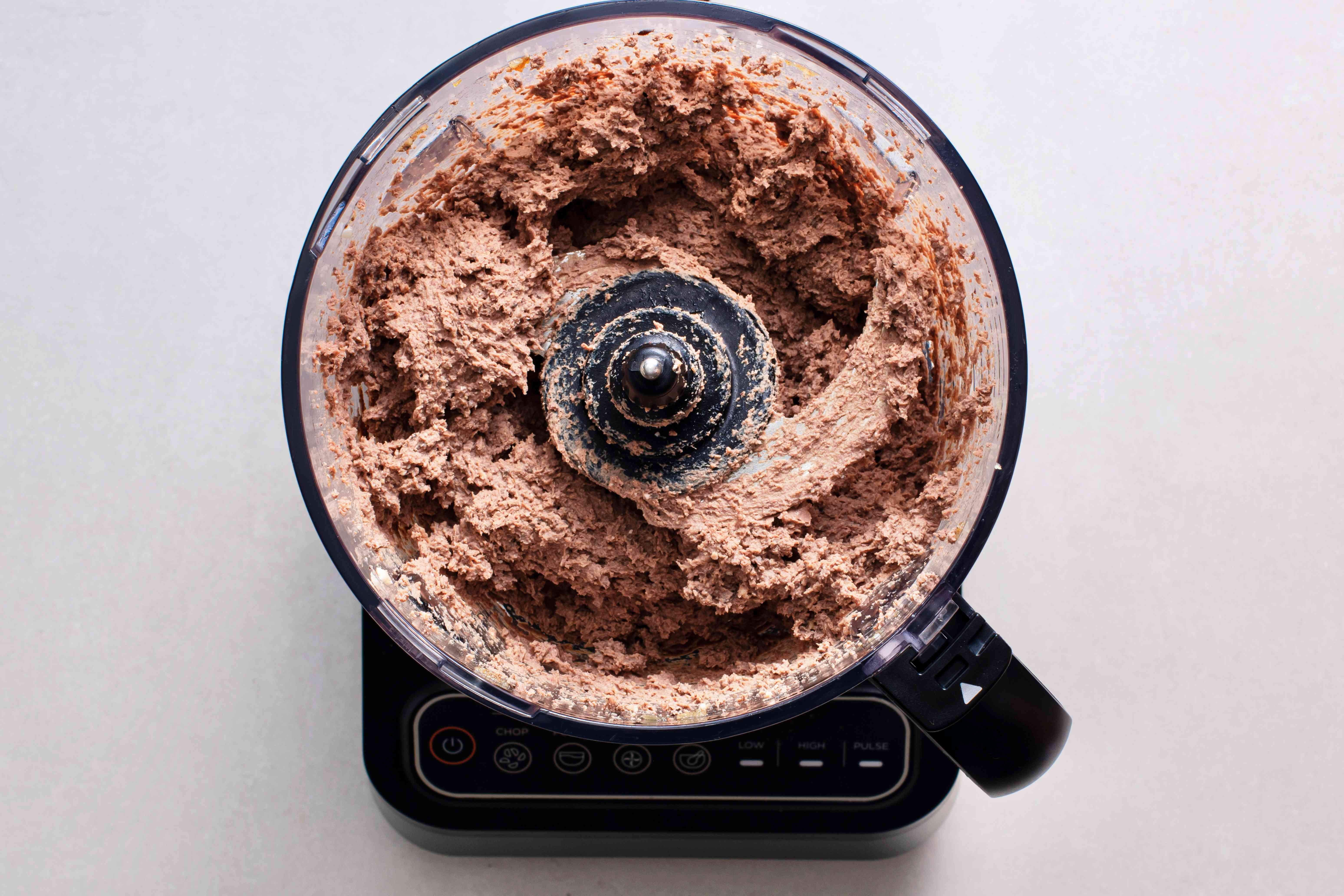 hard-boiled eggs, cooked chicken livers, black pepper, and nutmeg with onions in a food processor