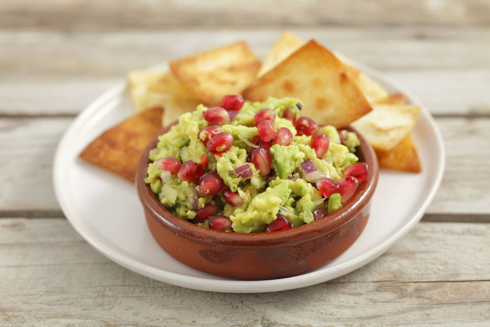 Guacamole with pomegranate seeds and tortilla chips