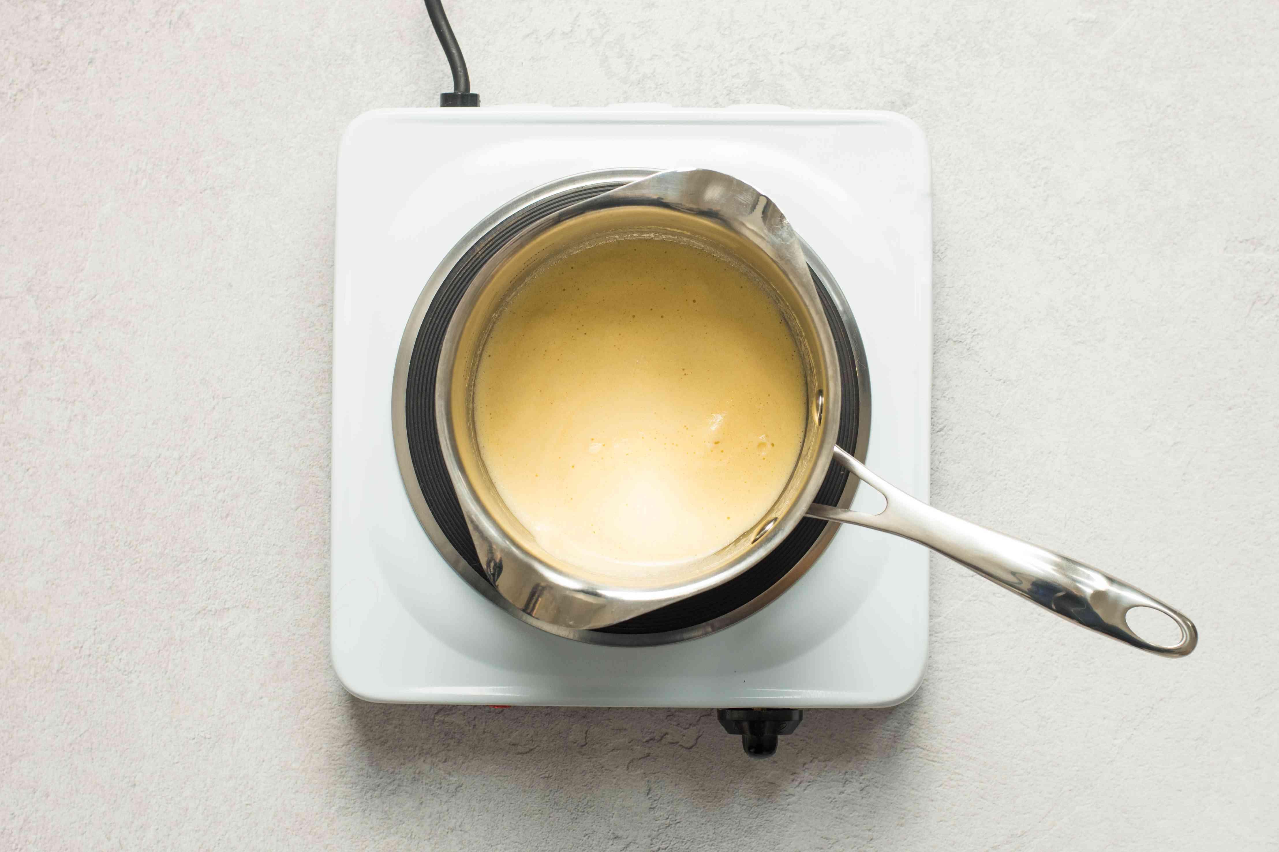 Place eggnog in saucepan
