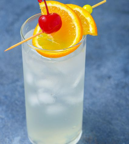 Vodka Collins cocktail garnished with orange and cherry