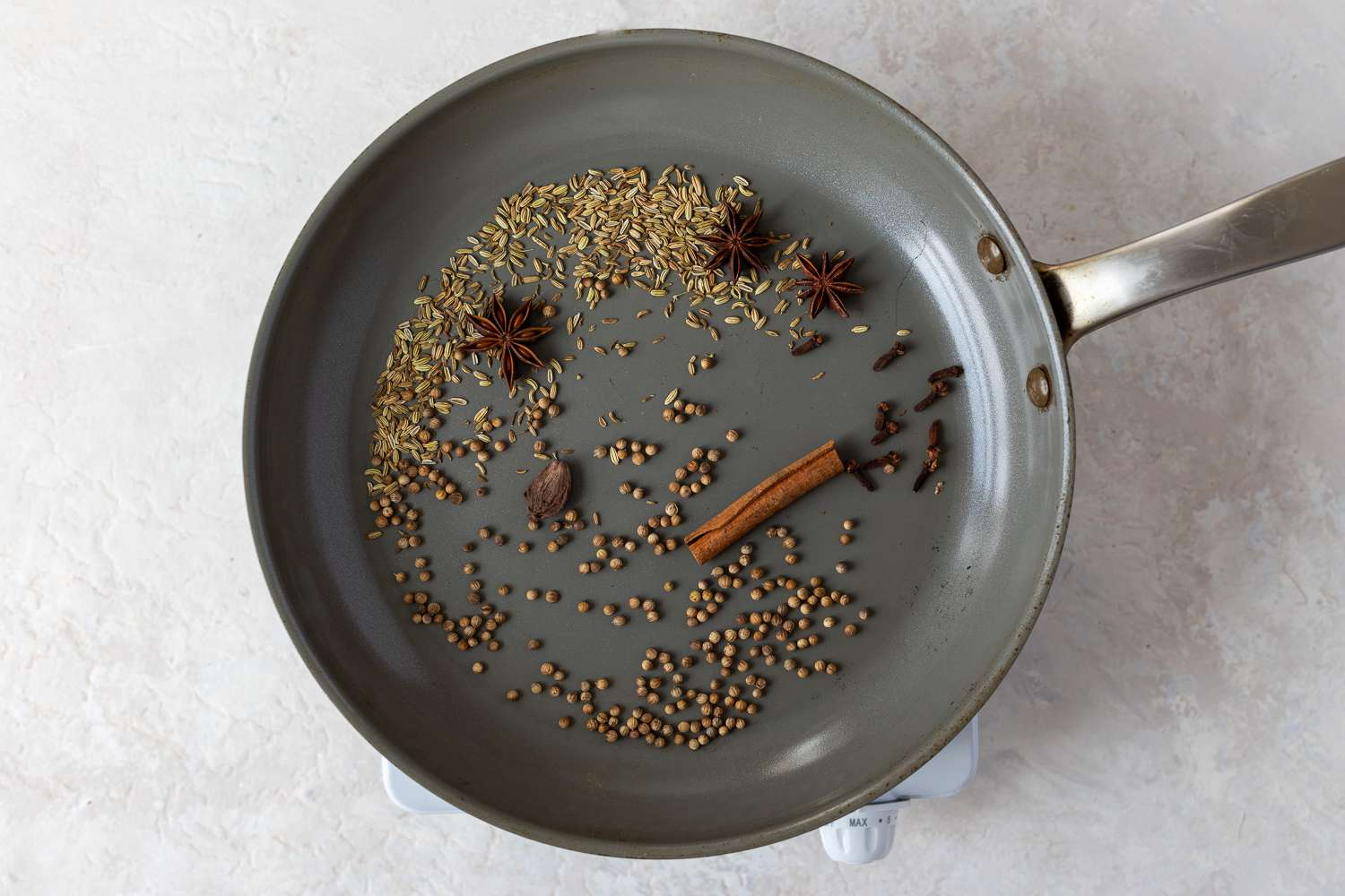 spices toasting in a pan