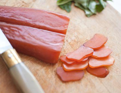 Sliced bottarga on a cutting board