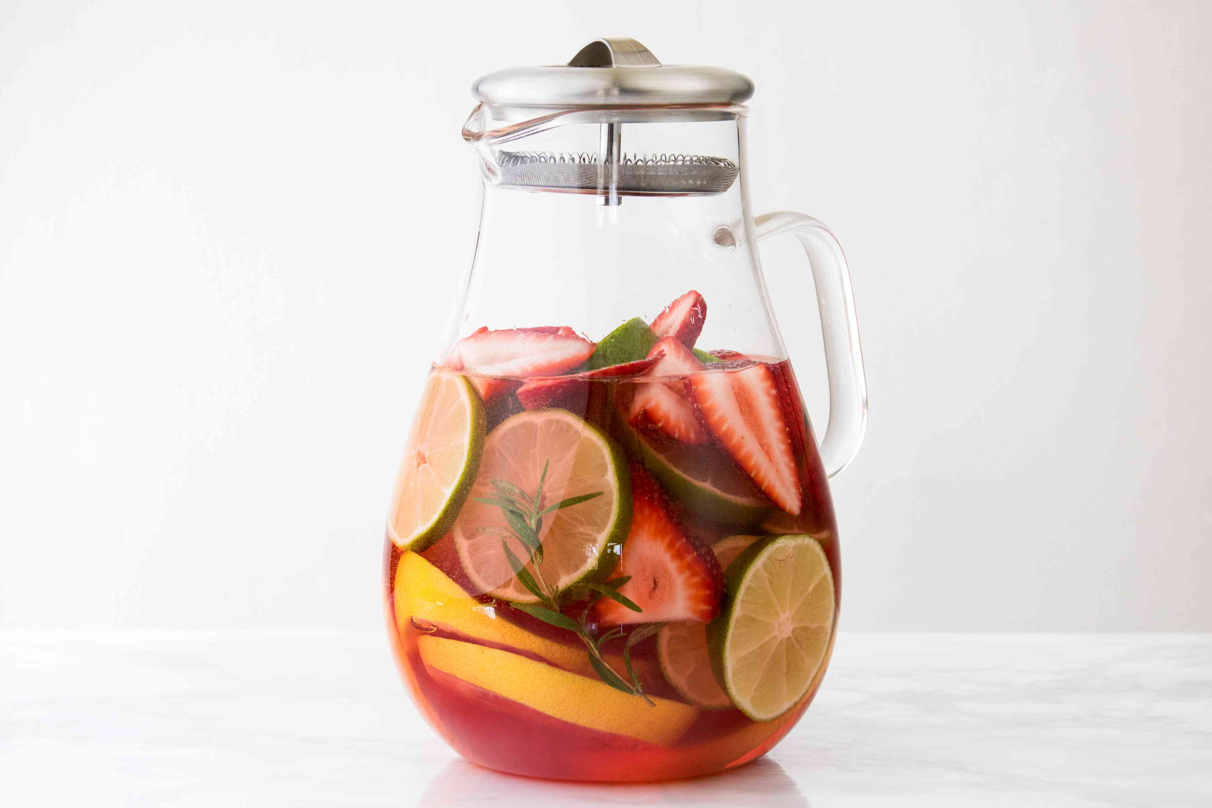 Mixing a Low-Sugar Citrus, Strawberry, and Rosemary Sangria