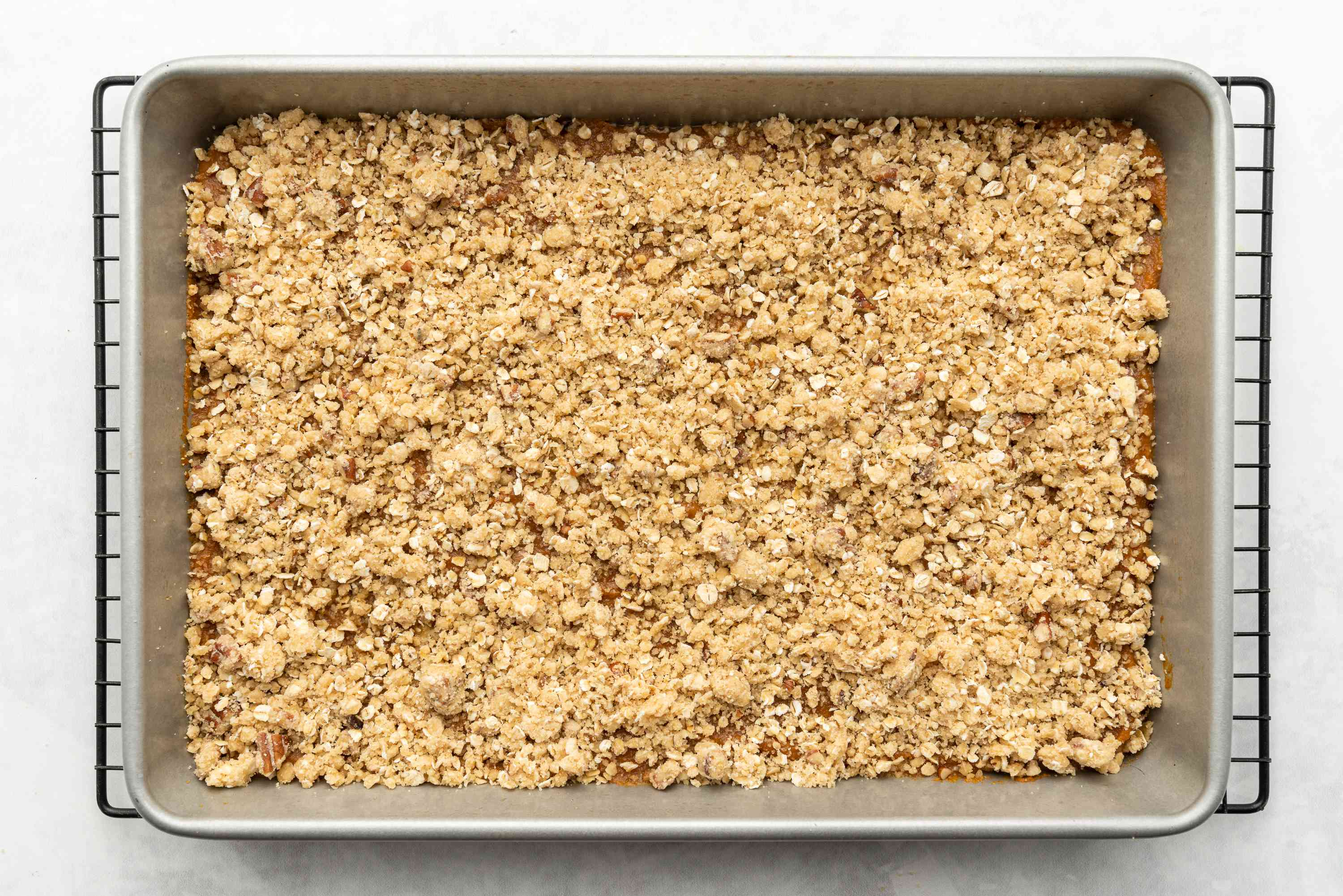 baked crumble in a baking pan on a cooling rack