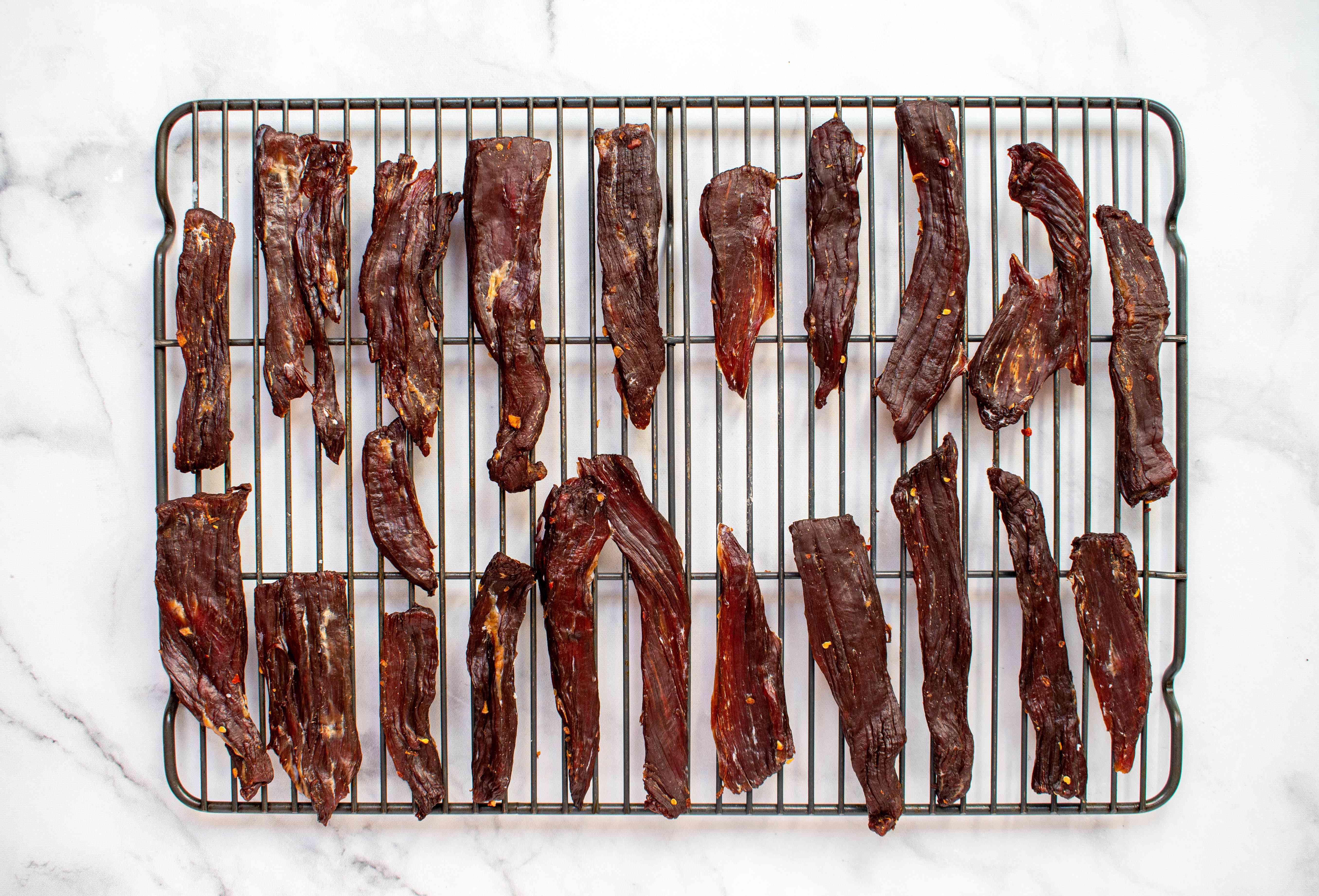 Hawaiian-Style Beef Jerky Recipe (Pipi Kaula) Recipe on a metal rack