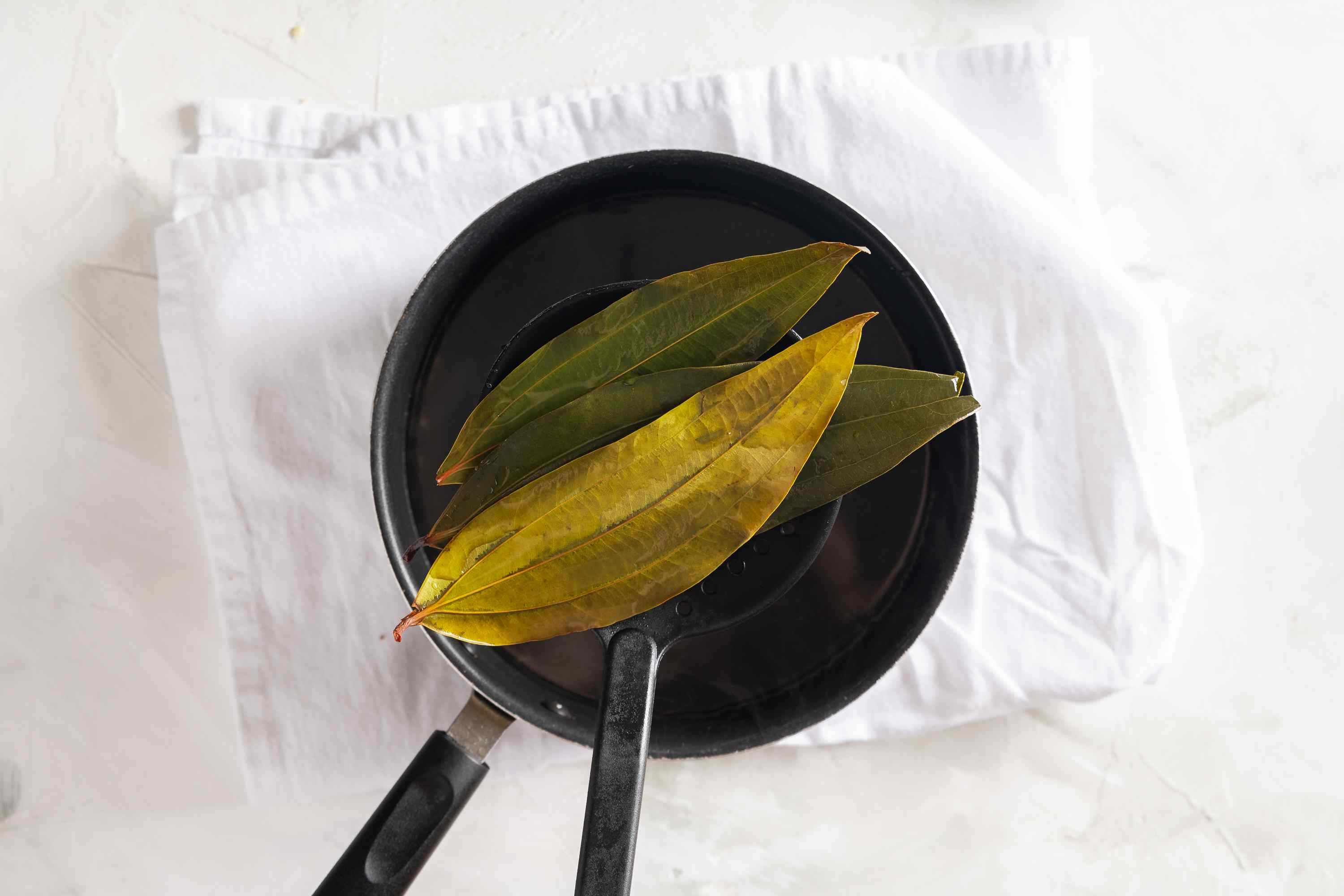Strain out the bay leaves from the pot