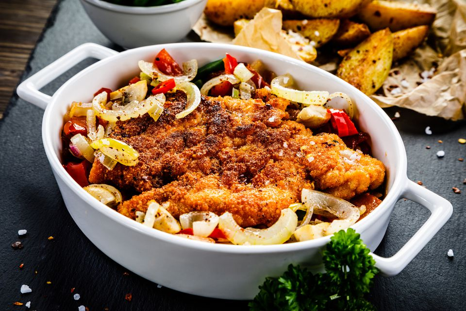 Pork chops with onions in casserole dish
