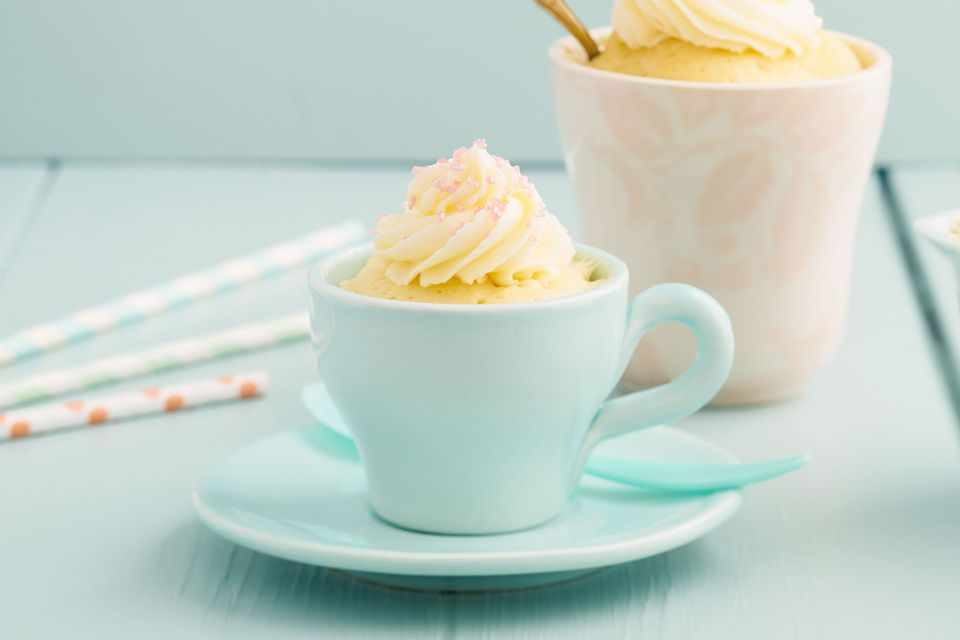 Tres Leches mug cake topped with whipped cream
