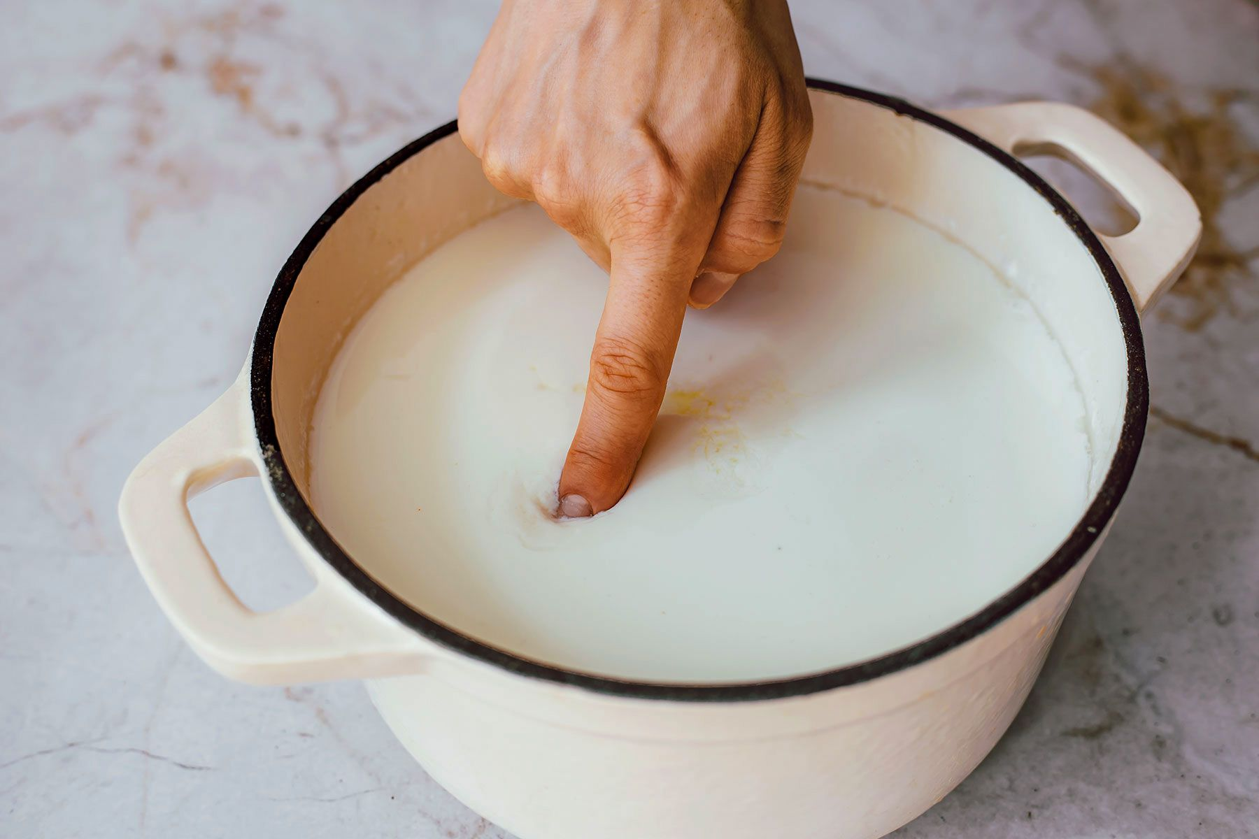 Poke a clean finger about an inch deep into the curd