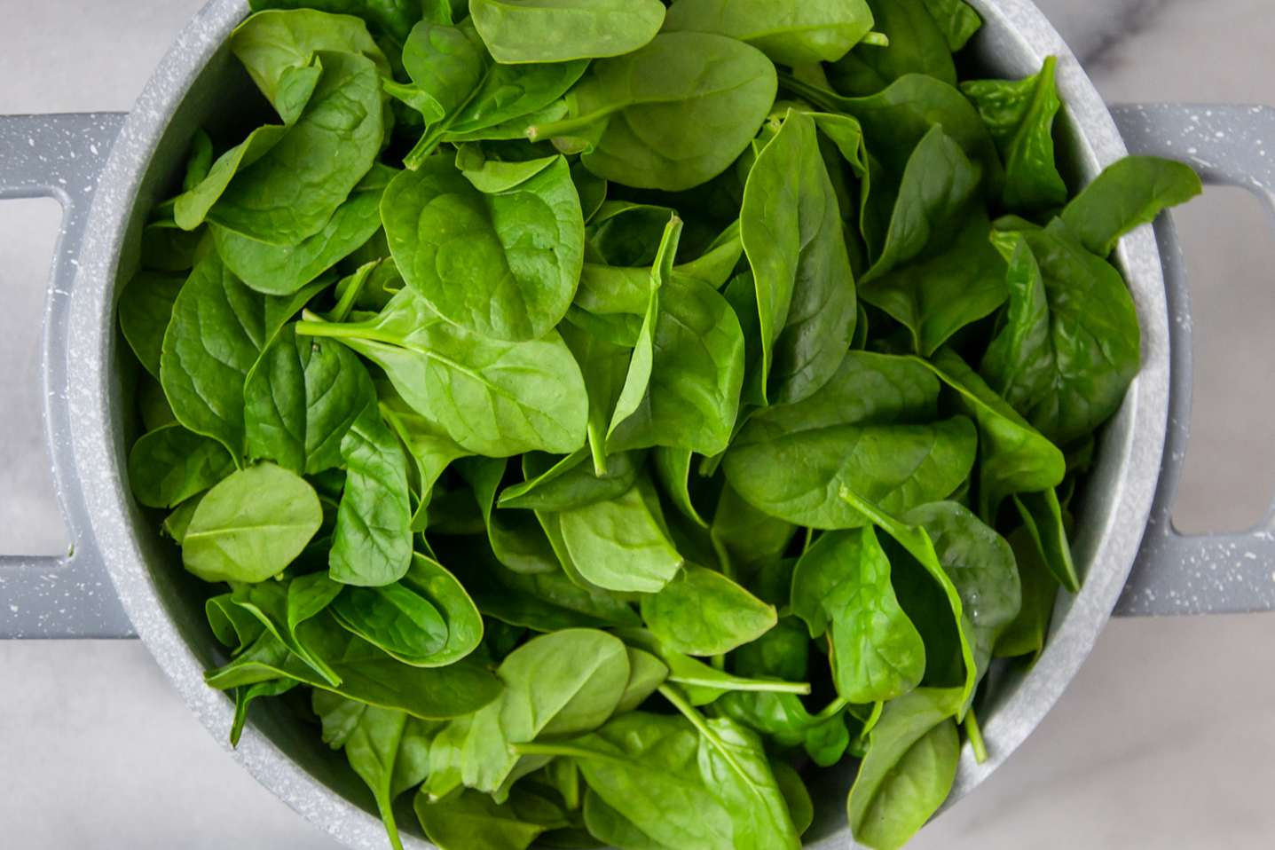 spinach added to saucepan with onion soup mix