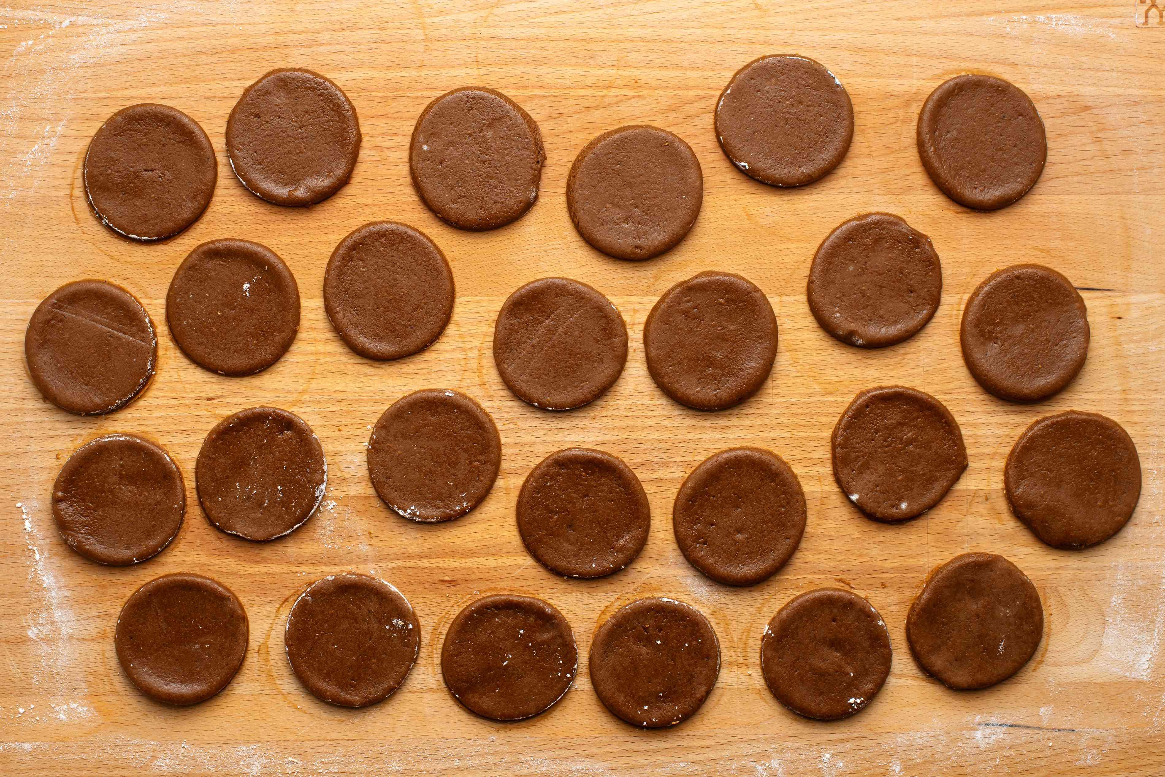 molasses cookie dough pieces on a floured surface