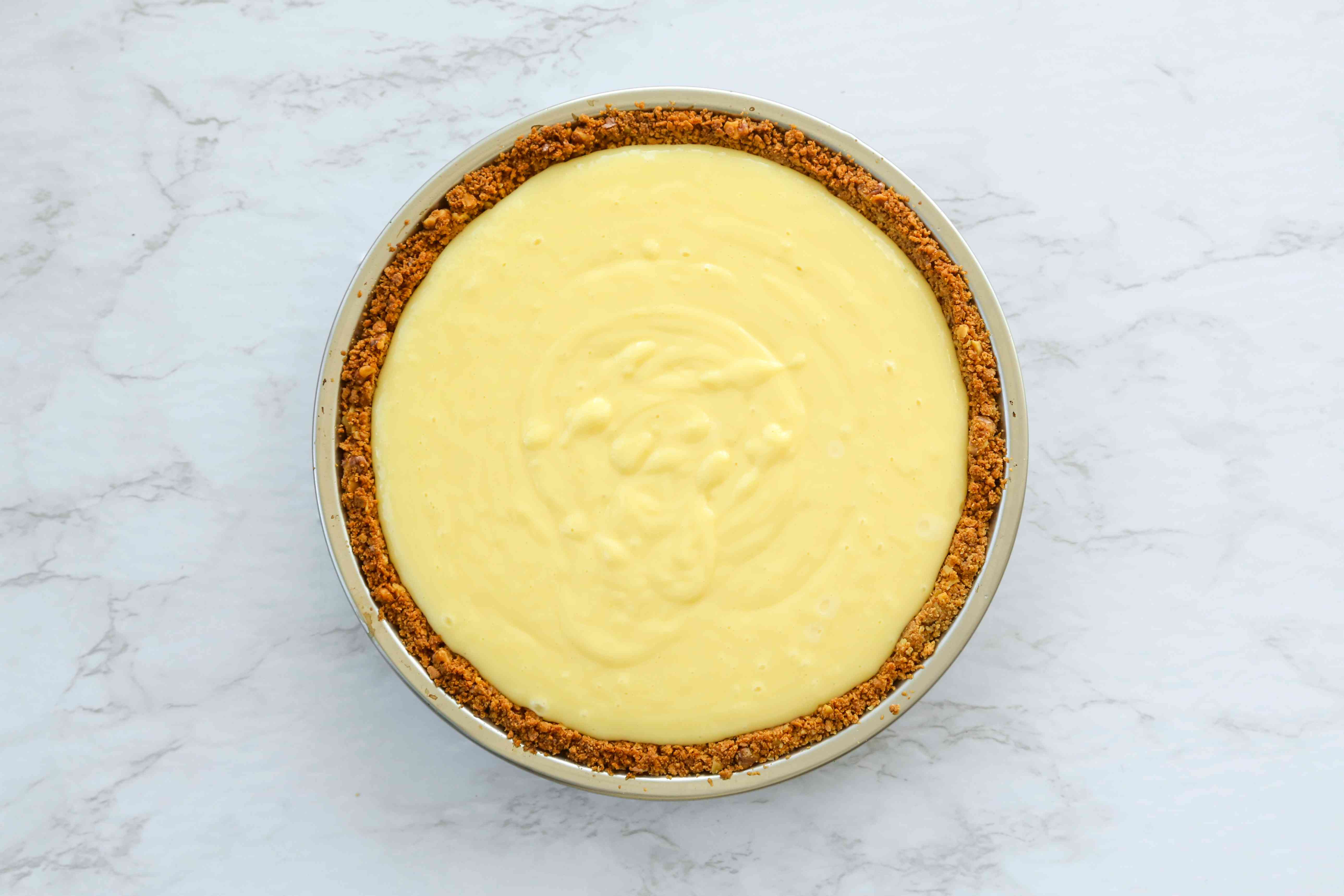 combine the egg yolks with the condensed milk and lemon juice and pour into the pie crust