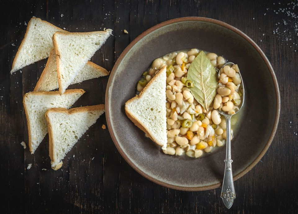 Slow cooker great Northern beans in a bowl with bread slices