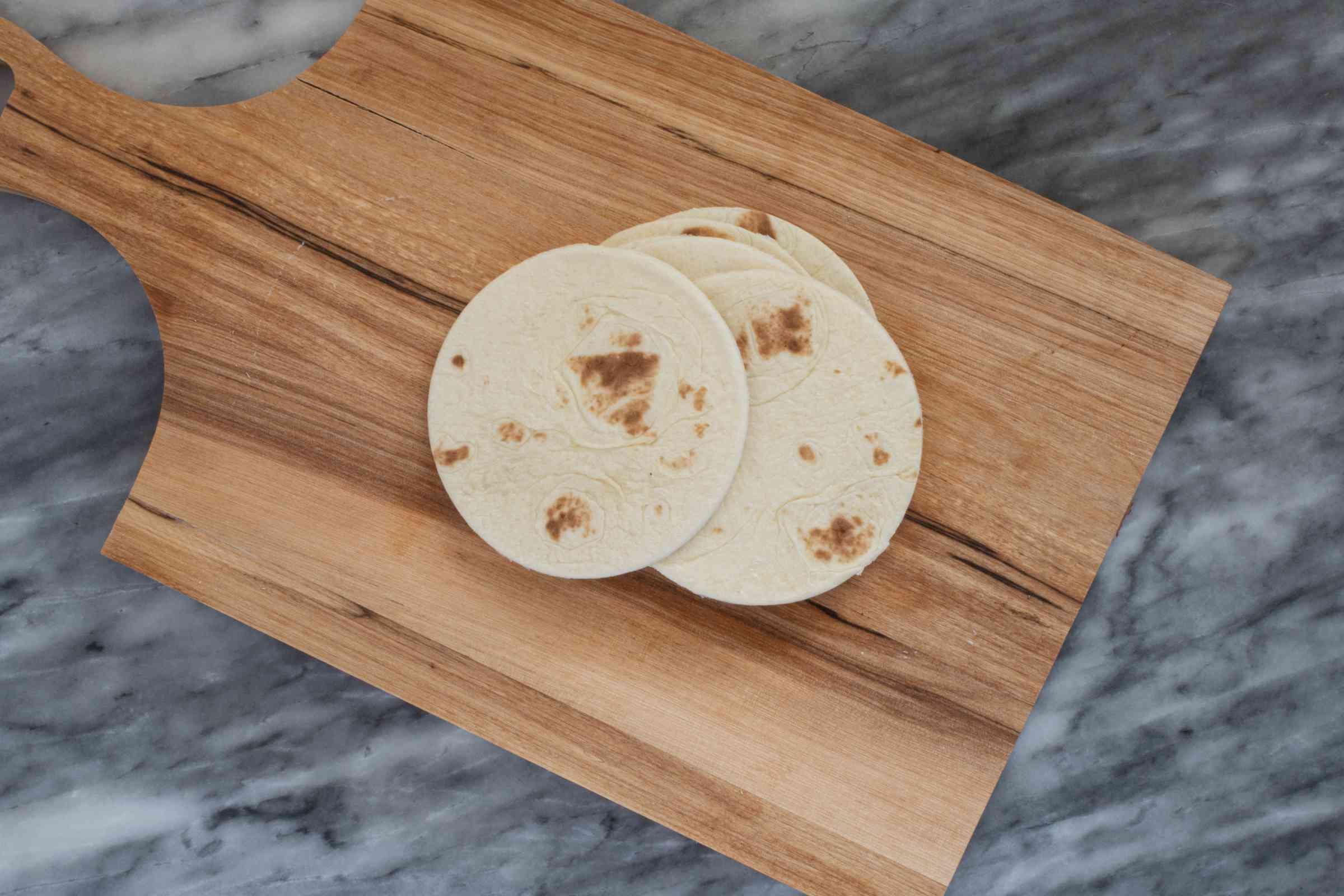 Make the tortillas bun-size.
