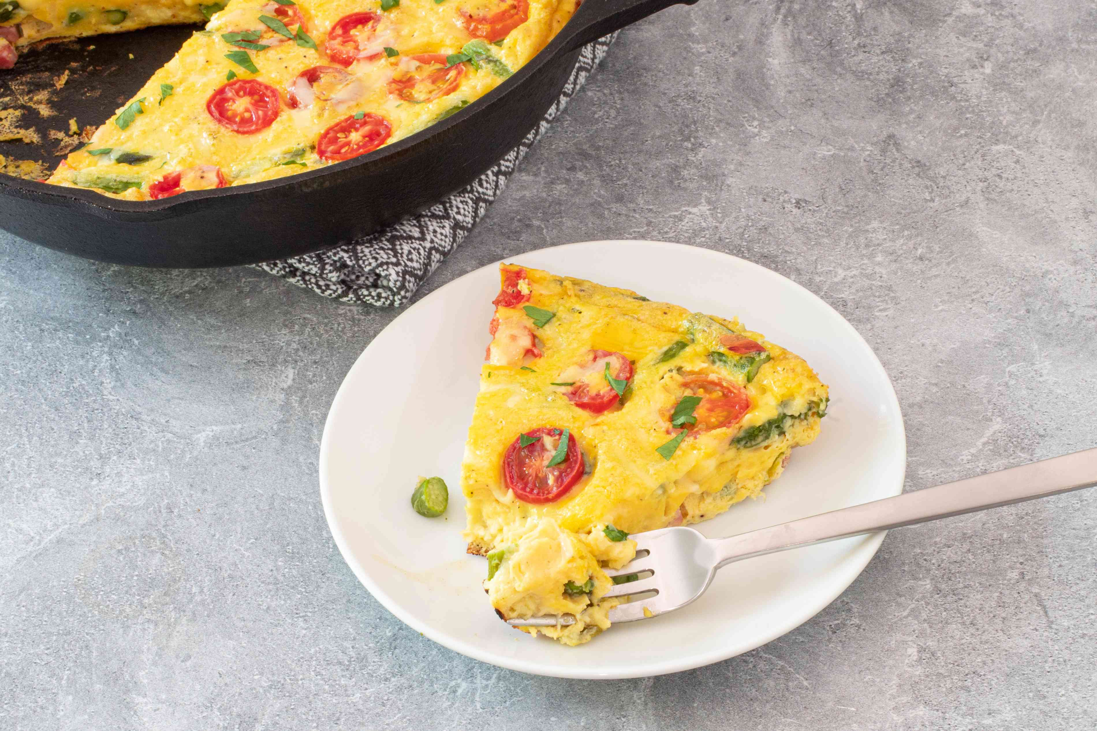 slice of frittata next to the skillet
