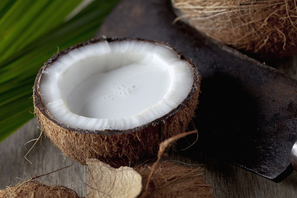 Coconut half with coconut milk